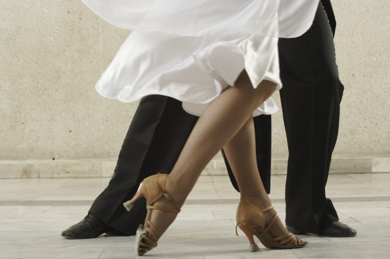 Young dancing pair in classical suits